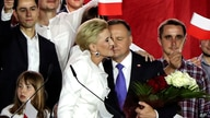 Incumbent President Andrzej Duda is hugged by his wife Agata Kornhauser-Duda in Pultusk, Poland, Sunday, July 12, 2020. An exit…