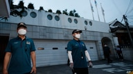 Police officers stand guard in front of the official residence of Seoul Mayor Park Won-soon in Seoul, South Korea, Thursday,…
