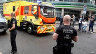 An ambulance which is believed to transport Alexei Navalny arrives at the Charite hospital in Berlin, Germany, Saturday, Aug.22…