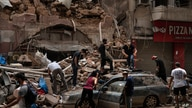 People remove debris from a house damaged by Tuesday's explosion in the seaport of Beirut, Lebanon, Friday, Aug. 7, 2020. …