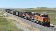 A BNSF Railway train hauling carloads of coal from the Powder River Basin of Montana and Wyoming is seen east of Hardin, Mont.,…