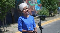 Democrat Rep. Ilhan Omar addresses media after lunch at the Mercado Central in Minneapolis Tuesday, Aug. 11, 2020, primary…