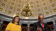 Senate Minority Leader Sen. Chuck Schumer of N.Y., right, speaks as he stands next to House Speaker Nancy Pelosi of Calif.,…