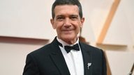 FILE - Antonio Banderas arrives at the Oscars in Los Angeles on Feb. 9, 2020.  Banderas says he's tested positive for COVID-19…
