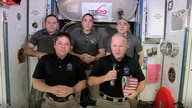 This photo provided by NASA shows, from left, front, astronauts Bob Behnken and Doug Hurley during an interview on the…