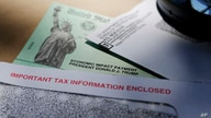 FILE - In this April 23, 2020, file photo, President Donald Trump's name is seen on a stimulus check issued by the IRS to help…