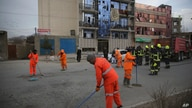 Afghan Municipality workers sweep a road after a bomb explosion in Kabul, Afghanistan, Wednesday, Feb. 26, 2020. Afghan…
