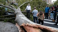 New York City Mayor Bill de Blasio talks with residents about damage from Tropical Storm Isaias, Tuesday, Aug. 4, 2020, in the…