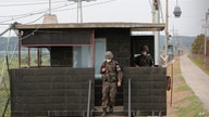 South Korean army soldiers step down from their military guard post in Paju, South Korea, near the border with North Korea,…