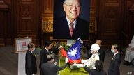 A Taiwanese flag is laid during a memorial service for the late former Taiwanese President Lee Teng-hui in Taipei, Taiwan on…