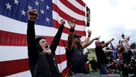 Members of the Proud Boys cheer on stage as they and other right-wing demonstrators rally, Saturday, Sept. 26, 2020, in…