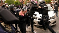 Police and protesters clash, Wednesday, Sept. 23, 2020, in Louisville, Ky. A grand jury has indicted one officer on criminal…