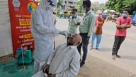 A health worker takes a nasal swab sample to test for COVID-19 test in Ahmedabad, India, Saturday, Sept. 26, 2020. The nation…