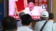 People watch a screen showing a file image of North Korean leader Kim Jong Un during a news program at the Seoul Railway…