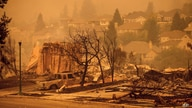 Homes leveled by the Glass Fire line a street in the Skyhawk neighborhood of Santa Rosa, Calif., on Monday, Sept. 28, 2020. (AP…