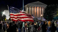 People gather at the Supreme Court in Washington, Saturday night, Sept. 19, 2020, to honor the late Justice Ruth Bader Ginsburg…