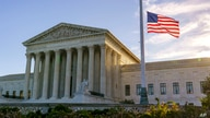 The flag flies at half-staff at the Supreme Court on the morning after the death of Justice Ruth Bader Ginsburg, 87, Saturday,…