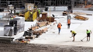 Workers go about their duties at a construction site in Sydney, Wednesday, Sept. 2, 2020. Australia's economy has suffered its…