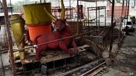 Carnival parade floats sit unfinished in the Unidos de Padre Miguel samba school workshop, in Rio de Janeiro, Brazil, Monday,…