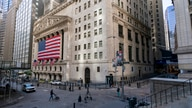 A giant American Flag hangs on the New York Stock Exchange, Monday, Sept. 21, 2020. Stocks are falling on Wall Street Monday,…