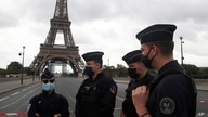 French police officers secure the bridge leading to the Eiffel Tower, Wednesday, Sept. 23, 2020 in Paris. Paris police have…
