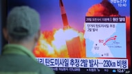 A man watches a TV screen showing a file image of North Korea's missile launch during a news program at the Seoul Railway…