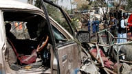 Afghan security personnel work at the site of an explosion in Kabul, Afghanistan, Wednesday, Sept. 9, 2020. Afghanistan's…