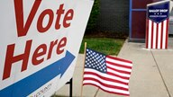 FILE - In this Oct. 20, 2020 file photo, a voting location is shown in Mission, Kan. A new survey by The Associated Press-NORC…
