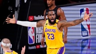 Los Angeles Lakers forward LeBron James reacts during the first half in Game 4 of basketball's NBA Finals Tuesday, Oct. 6, 2020…