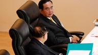 Thailand's Prime Minister Prayuth Chan-ocha, top, talks to Deputy Prime Minister Prawit Wongsuwan during the special session at…