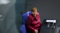 German Chancellor Angela Merkel attends a debate about German government's policies to combat the spread of the coronavirus and…