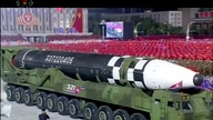 This image made from video broadcasted by North Korea's KRT, shows a military parade with what appears to be possible new…