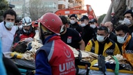 Rescue workers carry a seven-year-old girl rescued from a collapsed building in Izmir, Turkey, Saturday, Oct. 31, 2020. Rescue…