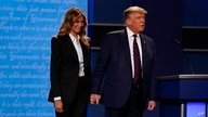 President Donald Trump and first lady Melania Trump on stage at the end of the first presidential debate Tuesday, Sept. 29,…