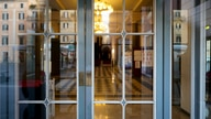 The foyer of the closed Argentina theater is seen through its locked entrance, in Rome, Monday, Oct. 26, 2020. For at least the…