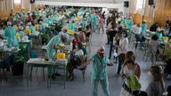 FILE - In this Wednesday, Sept. 2, 2020 file photo, teachers and auxiliary staff take COVID-19 tests in Madrid, Spain…