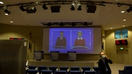 European Commission President Ursula von der Leyen, right, speaks via video conference into a press room at EU headquarters in…