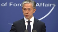 Chinese foreign ministry spokesman, Wang Wenbin, speaks during a routine press conference where he congratulated U.S. president…
