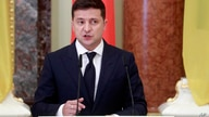 Ukrainian President Volodymyr Zelenskiy speaks during a joint news briefing with Polish President Andrzej Duda as they meet in…
