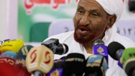FILE - In this Feb. 6, 2020 file photo, former Sudanese Prime Minister Sadiq al-Mahdi, left, leader of the Umma political party…