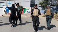 Afghan police arrive at the site of an attack at Kabul University in Kabul, Afghanistan, Monday, Nov. 2, 2020. Gunfire erupted…