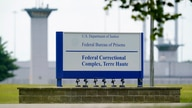 FILE - This Aug. 28, 2020, file photo shows the federal prison complex in Terre Haute, Ind. The Justice Department is quietly…