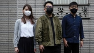 CORRECTS DATE - Hong Kong activists, from right, Joshua Wong, Ivan Lam and Agnes Chow arrive at a court in Hong Kong, Monday,…