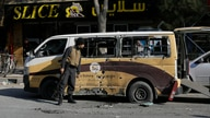 Afghan security checks a car destroyed in a rocket attack in Kabul, Afghanistan,Saturday, Nov. 21, 2020. Multiple rockets were…