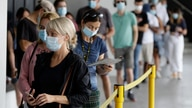People wait in a line at a COVID-19 testing station on the northern beaches in Sydney, Australia, Monday, Dec. 21, 2020. Sydney…