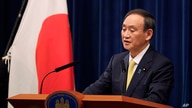 Japanese Prime Minister Yoshihide Suga speaks during a news conference in Tokyo on Friday, Dec. 4, 2020. Suga announced a 2…