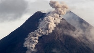 Hot cloud of volcanic materials run down the slope of Mount Merapi during an eruption in Sleman, Wednesday, Jan. 27, 2021…