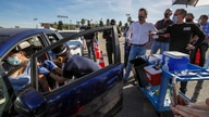 FILE - In this Jan. 15, 2021, file photo, Los Angeles Mayor Eric Garcetti, right, and Governor Gavin Newsom tour the mass COVID…