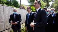 Greek Prime Minister Kyriakos Mitsotakis, center right, visits The Righteous Among the Nations Memorial during a visit to the…