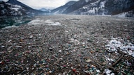 Plastic bottles and waste float at the Potpecko accumulation lake near Priboj, in southwest Serbia, Friday, Jan. 22, 2021…
